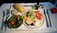 A gourmet appetizer and seasonal salad served in Air France's Business cabin