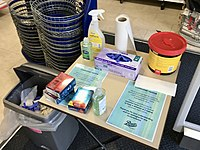 A table inside the entrance to Boots, in the high street, with hand sanitizer and disposable gloves which customers are required to use