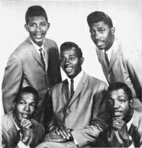"""A promotional image of the original early 1960s Temptations lineup. Clockwise from top right: Otis Williams, Paul Williams, Melvin Franklin, Eddie Kendricks, and Elbridge """"Al"""" Bryant."""