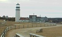 Highland Light. The original site is marked by a boulder in the foreground.