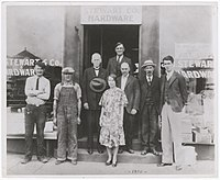 Stewart (right) and Alexander Stewart (high center) in front of the family hardware store in 1930