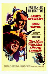With John Wayne in the film poster for The Man Who Shot Liberty Valance (1962)