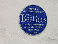 Bee Gees plaque at Maitland Terrace/Strang Road intersection in Union Mills, Isle of Man