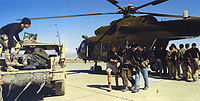 US Special Forces help Northern Alliance troops away from a CIA-operated MI-17 Hip helicopter at Bagram Airbase, 2002
