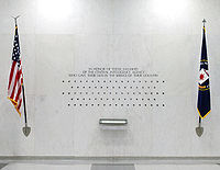 The 113 stars on the CIA Memorial Wall in the original CIA headquarters, each representing a CIA officer killed in action
