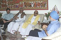 The Chief Minister of Tamil Nadu, Karunanidhi meeting the Deputy Chairman of Planning Commission, Montek Singh Ahluwalia to finalise plan for the financial year, in New Delhi on 6 June 2006