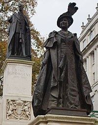 Bronze statue of Elizabeth on The Mall, London, overlooked by the statue of her husband King George VI