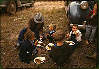 A Homesteader and his children at the New Mexico Fair in Pie Town, New Mexico, 1940