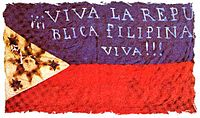 """Early flag of the Filipino revolutionaries (""""Long live the Philippine Republic!!!""""). The first two constitutions were written in Spanish."""