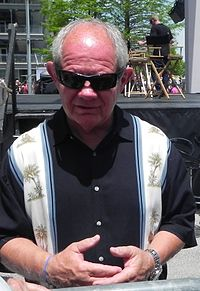 Paul Page, the Chief Announcer from 1977 to 1987, and again from 2014 to 2015.