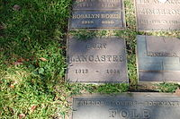 Lancaster's plaque under an oak tree in Westwood Memorial Park where his ashes were scattered