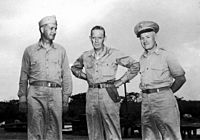 """The """"Tinian Joint Chiefs"""": Captain William S. Parsons (left), Rear Admiral William R. Purnell (center), and Brigadier General Thomas F. Farrell (right)"""
