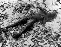 Partially incinerated child in Nagasaki. Photo from Japanese photographer Yōsuke Yamahata, one day after the blast and building fires had subsided. Once the American forces had Japan under their military control, they imposed censorship on all such images including those from the conventional bombing of Tokyo; this prevented the distribution of Yamahata's photographs. These restrictions were lifted in 1952.
