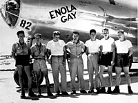"""The Enola Gay dropped the """"Little Boy"""" atomic bomb on Hiroshima. Paul Tibbets (center in photograph) can be seen with six of the aircraft's crew."""