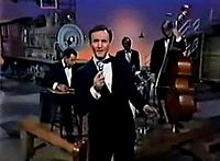 """Miller performing """"Husbands and Wives"""" on the set of his television show in 1966"""
