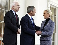 President Bush holds Cindy McCain's hand as he endorses her husband for president, March 5, 2008.