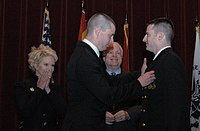 McCain and his wife Cindy watch in 2011 as their son Jimmy pins aviator wings on their son Ensign John Sidney McCain IV.