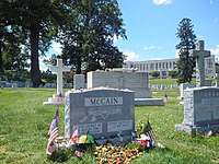 Grave of John McCain III next to his Naval Academy classmate Charles R. Larson at the United States Naval Academy Cemetery