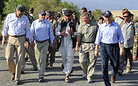 """The """"Three Amigos"""" walking in Kunar Province in eastern Afghanistan in July 2011: McCain (second from left), Lindsey Graham (second from right in front), Joe Lieberman (right in front)"""