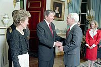 President Ronald Reagan greets McCain as First Lady Nancy Reagan looks on, March 1987