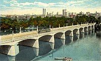 By the early 20th century Richmond had an extensive network of electric streetcars, as shown here crossing the Mayo Bridge across the James River, c. 1917.