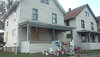 363 Covert Court in Ashland, OH where Grate was arrested, a public memorial is in front of the house.