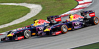 Vettel (left) controversially passing teammate Mark Webber at the 2013 Malaysian Grand Prix, despite team orders to maintain position