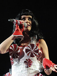 Perry's characteristic spinning peppermint swirl dress which she wore on her California Dreams tour