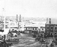 The Parade in 1883, with a railroad station built in 1864 at right (replaced by New London Union Station in 1887) and ferryboats in the river