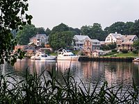 alt=Boats and waterfront homes in Warwick Boats and homes in Warwick, the second most populous city in Rhode Island