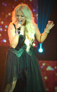 Amelia Lily, a finalist on The X Factor, signed to Xenomania Records in 2012.