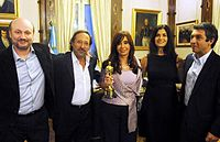 President Cristina Fernández with the film director Juan José Campanella and the cast of The Secret in Their Eyes (2009) with the Oscar for Best Foreign Language Film
