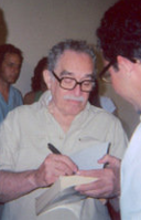 García Márquez signing a copy of One Hundred Years of Solitude