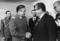 Chilean dictator Augusto Pinochet shaking hands with U.S. Secretary of State Henry Kissinger in 1976