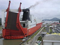 Roll-on/roll-off ships, such as this one pictured here at Miraflores locks, are among the largest ships to pass through the Panama Canal. The canal cuts across the Isthmus of Panama and is a key conduit for international maritime trade.