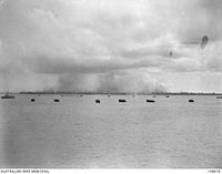 American support craft moving towards Victoria and Brown beach to assist the landing of the members of Australian 24th Infantry Brigade on the island during Operation Oboe Six, 10 June 1945