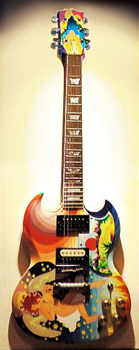 """Clapton's The Fool guitar (replica shown), with its bright artwork and famous """"woman tone"""", was symbolic of the 1960s psychedelic rock era."""
