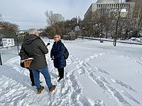 Michelle Douglas being interviewed by CBC's Chris Hall at the future site of the LGBTQ2+ National Monument in Ottawa, January 2020