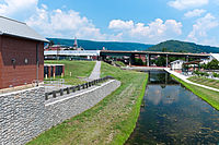 Terminus of the Chesapeake and Ohio Canal in Cumberland. Highway bridge is Interstate 68. Canal Place Museum is the brick building behind bridge.