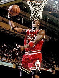 Michael Jordan goes to the basket for a slam dunk in 1987.