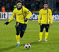 Ibrahimović preparing to strike a free kick for Barcelona in the UEFA Champions League with Xavi (right)