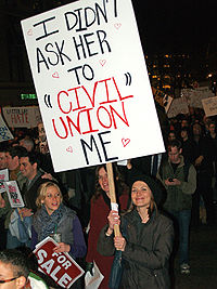 Various advocates of same-sex marriage, such as this protester at a demonstration in New York City against California Proposition 8, consider civil unions an inferior alternative to legal recognition of same-sex marriage.