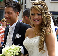 A newly married Assyrian couple.