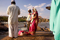 A Muslim couple being wed alongside the Tungabhadra River at Hampi, India.