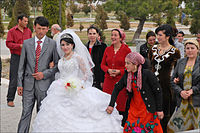 Newlywed couples visit Timur's statues to receive wedding blessings in Uzbekistan.