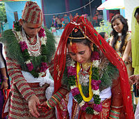 A Nepali Hindu couple in marriage ceremony.