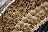 Detail of arabesque decoration at the Alhambra in Spain.