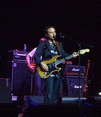 Nils Lofgren performing at the Beacon Theater Benefit For Arthur Lee