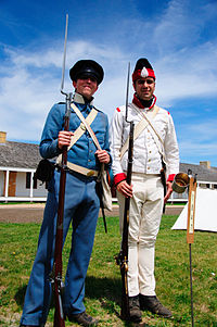 Reenactors in U.S. (left) and Mexican (right) uniforms of the period