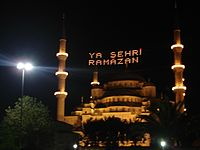 Sultan Ahmed Mosque with the kandils lit. The lights in this example spell out holiday greetings.